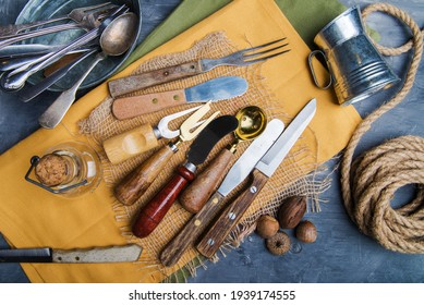 cutlery on a yellow napkin on the table. view from above