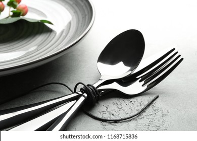 Cutlery with plate on light table