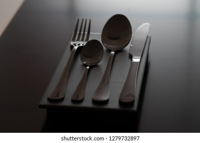 Cutlery spoon, fork and knife on black background