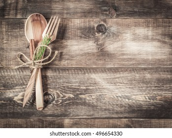 Cutlery spoon and fork on a wooden background