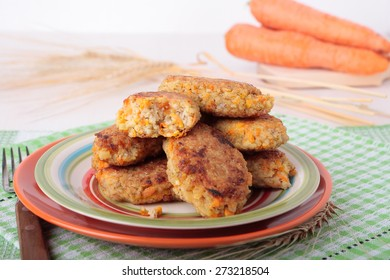 Cutlets of crushed barley porridge with carrots and onions on plate