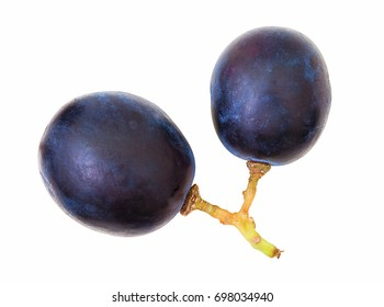 Cutout of blue grape berries, isolated on white background without shadow. Two ripe grape berries in white scene. Overhead shot, macro photography. Couple of blue ripe grape berries.