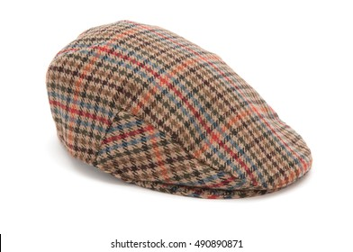 Cutout of a checked houndstooh tweed hunting hat or flat cap.