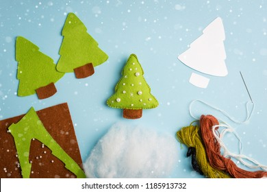 Cut-out details fur-tree toy. Fabric crafts for kids step by step. How to make a cute felt Christmas tree. Set to create a baby toy. Fun handmade idea for kids for new year