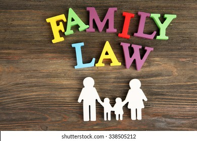 Cutout family and colourful letters regarding child-custody and family-law concept