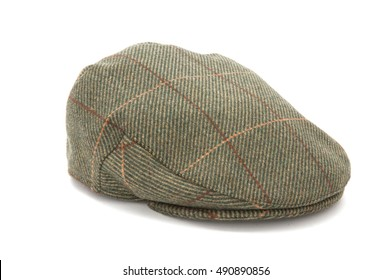 Cutout of a green tweed hunting hat or flat cap