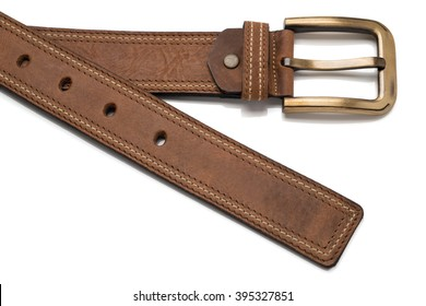 Cutout of a light brown faux leather belt showing tip and brass buckle.