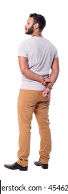 Cutout photo of latino man from the back. He crossed arms behind the back. Full length back view. Isolated on white background.