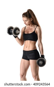 Cutout portrait of muscular young woman lifting a dumbbell for training her biceps