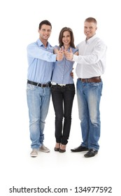 Cutout portrait of successful business group standing in huddle, doing thumb up, smiling.