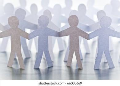 Cutouts of identical paper men