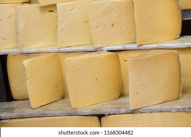 cuts of kashkaval or kasseri  cheese for sale on the shelf