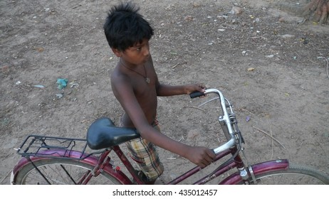 CUTTACK, INDIA - 17 MAY, 2016: An unidentified indian boy at street.
