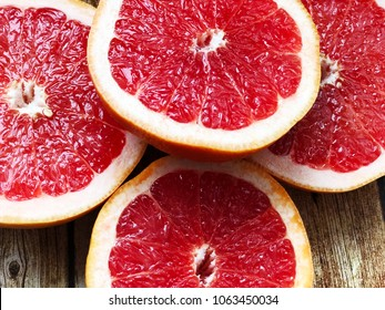 cutted grapefruit on wooden background. slidec grapefruits top view. juice grapefruit close up