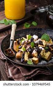 Cutted pancakes, Kaiserschmarrn delish dessert with plums, food photography, food stock
