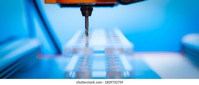 Cutter CNC router and plastic parts of Plexiglas