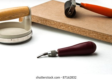 Cutter tool in front of block printing kit on white surface