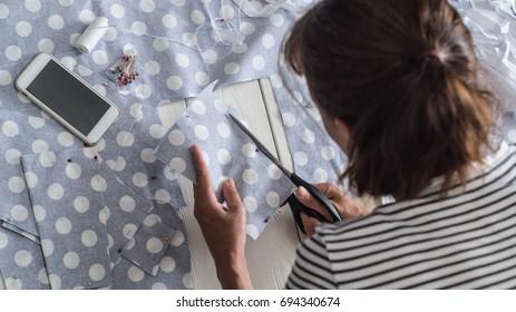 cutting blue fabric polka dot sewing the pattern