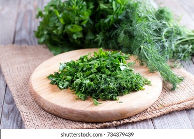 Cutting board with green chopped herbs