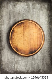 cutting board at old wooden table, top view
