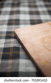 cutting board on checker pattern table mat.selective focus, shallow depth