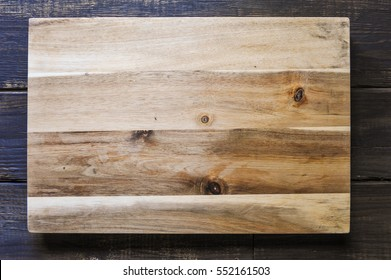 Cutting board on wood background