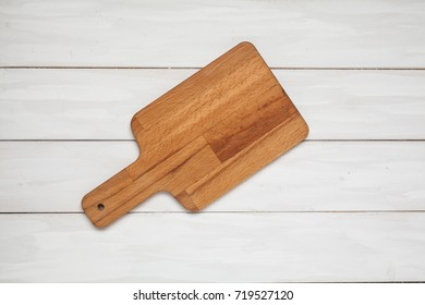 Cutting board on wood white plank background. Top view with copy space.