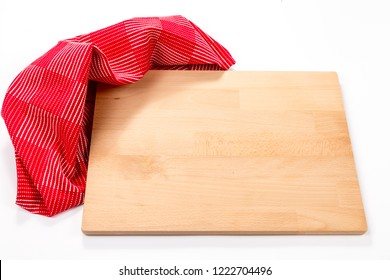 Cutting board and red napkin isolated on white