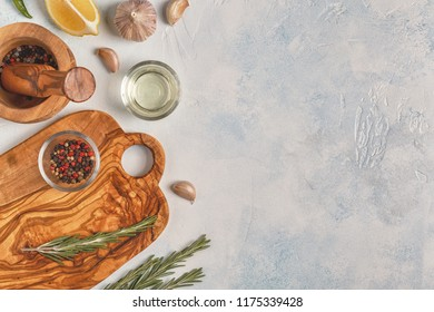 Cutting board and spice for cooking on a light background.