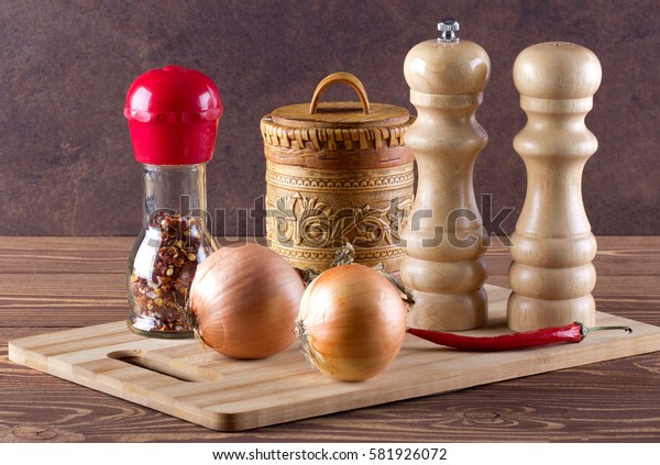 Cutting board with spice,onion,red pepper for cooking.