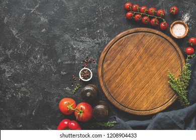 Cutting board, spices and vegetables for cooking. Food background. Top view, copy space for text, recipe or menu