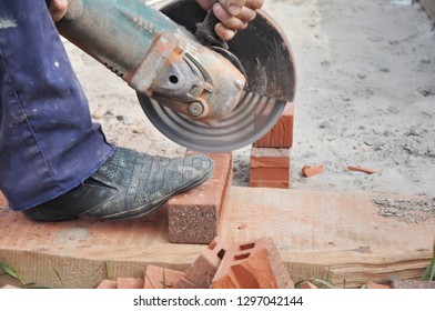 Cutting Brick with a Diamond Saw. Masonry Cutting. Contractor Cut a Brick With a Wet Saw. Circular saw is a power-saw with disk.