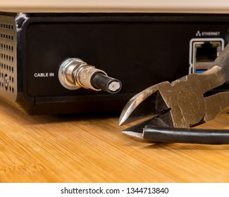 """""""cutting the cord"""" cable tv coax being cut"""