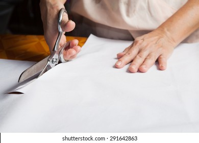 Cutting fabric with tailors scissors