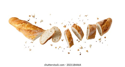 Cutting fresh baked loaf wheat baguette bread  with crumbs and seeds flying isolated on white background.