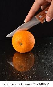 Cutting a fresh orange
