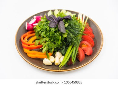 Cutting fresh vegetables on the white plate on white background.