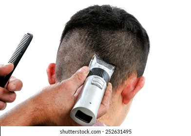 Cutting hair on young boy of Caucasian origin, photo on white background.