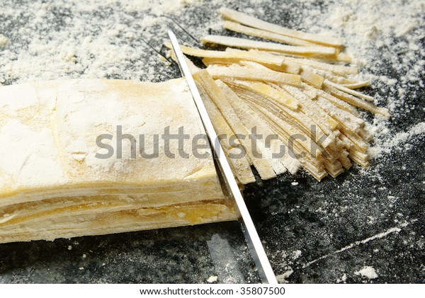 Cutting homemade noodles