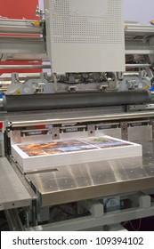 Cutting machine in a print shop
