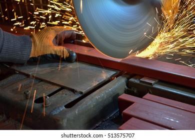 Cutting metal with cutting machine - worker