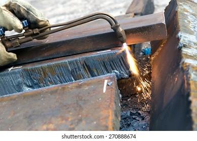 Cutting metal sheet with propane oxygen gas blow torch burner equipment