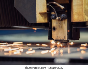 Cutting of metal. Sparks flying from laser machine.