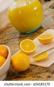 Cutting up oranges for orange juice.