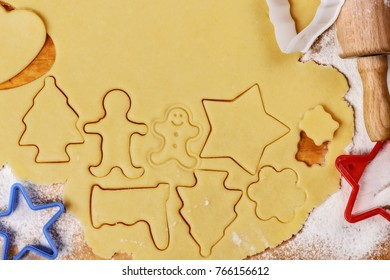 cutting out cookies from dough