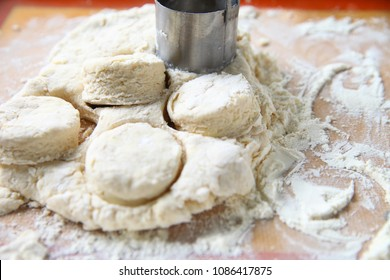 Cutting out Southern-style biscuits before baking