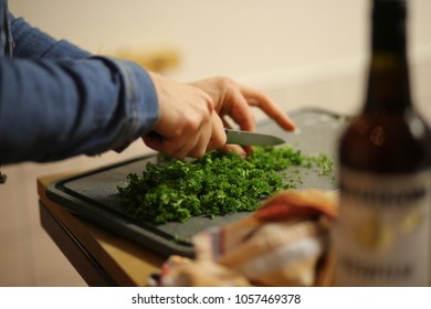 Cutting Parsley on a cutting board, Cooking with Parsley