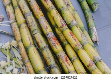 Cutting and peeling sugarcane