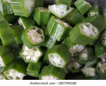 cutting pieces of lady finger, cutting pieces of okra