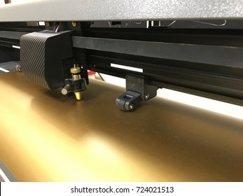 Cutting plotter. Film cutting machine. Gold film.